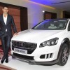 Photo Novak Djokovic et la Peugeot 508 RXH restylée 2014